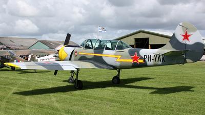 A picture of PHYAK - Aerostar Yak52 - [877401] - © Ronald Vermeulen