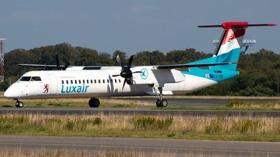 A picture of LXLQD - De Havilland Canada Dash 8400 - Luxair - © Julian S.