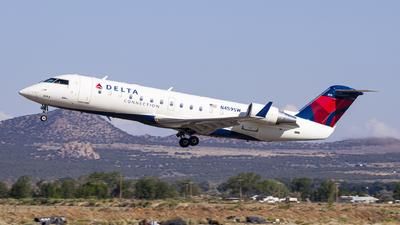 A picture of N459SW - Mitsubishi CRJ200LR - Delta Air Lines - © David Lee