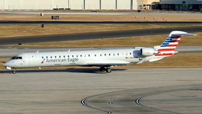 A picture of N606NN - Mitsubishi CRJ900LR - American Airlines - © Paul Y. M. Chow - AHKGAP