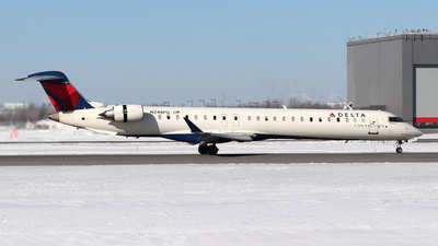 A picture of N348PQ - Mitsubishi CRJ900LR - Delta Air Lines - © Guy Langlois