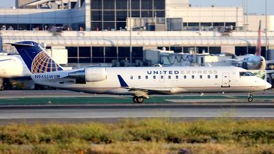A picture of N945SW - Mitsubishi CRJ200LR - United Airlines - © Wojtek Kmiecik
