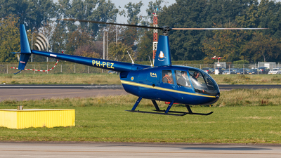 A picture of PHPEZ - Robinson R44 Raven II - [10479] - © Kelvin Jahae