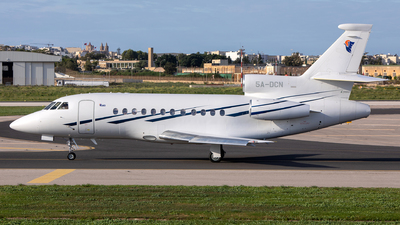 A picture of 5ADCN - Dassault Falcon 900EX - [148] - © Chris Camille