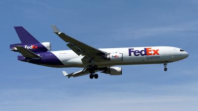 A picture of N589FE - McDonnell Douglas MD11F - FedEx - © Mitsuhiro Yamamoto