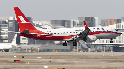 A picture of B7396 - Boeing 73789P - Shanghai Airlines - © Lixing Moo