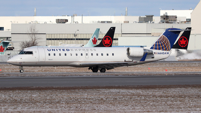 A picture of N440AW - Mitsubishi CRJ200LR - United Airlines - © Guy Langlois