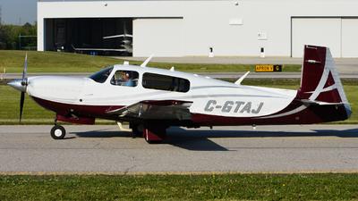 A picture of CGTAJ - Mooney M20TN - [310110] - © Aaron Miles