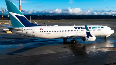 A picture of CGWRG - Boeing 7378CT - WestJet - © Derek MacPherson