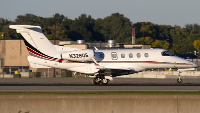 A picture of N328QS - Embraer Phenom 300 - NetJets - © Jeremy D. Dando
