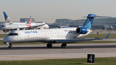 A picture of N520GJ - Mitsubishi CRJ550 - United Airlines - © Ben Suskind