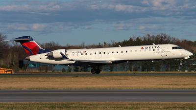 A picture of N317CA - Mitsubishi CRJ701ER - Delta Air Lines - © Daniel Evans