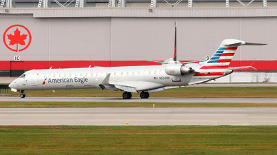 A picture of N558NN - Mitsubishi CRJ900LR - American Airlines - © Guy Langlois