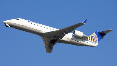 A picture of N970SW - Mitsubishi CRJ200LR - United Airlines - © Michael Rodeback