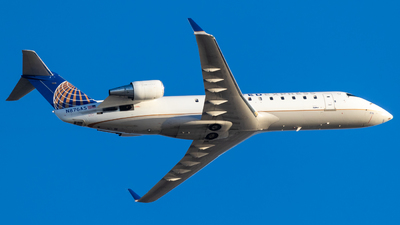 A picture of N876AS - Mitsubishi CRJ200ER - United Airlines - © Alex Crail