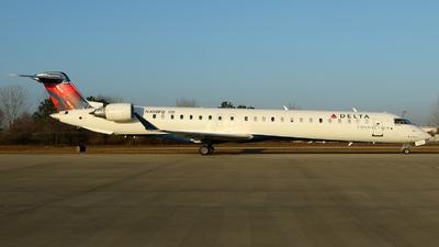 A picture of N308PQ - Mitsubishi CRJ900LR - Delta Air Lines - © Carlos Barcelo