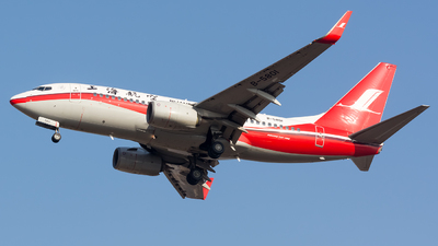 A picture of B5801 - Boeing 73776D - Shanghai Airlines - © BobH