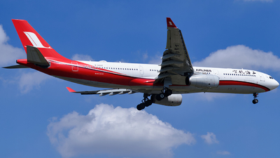 A picture of B6097 - Airbus A330343 - Shanghai Airlines - © LeoRay