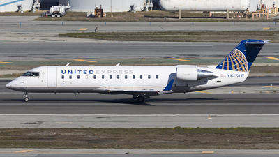 A picture of N939SW - Mitsubishi CRJ200LR - United Airlines - © David Lee