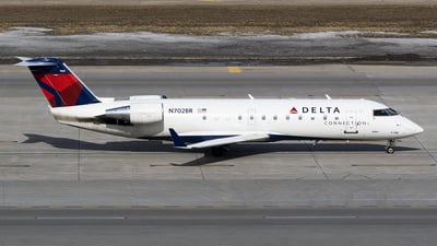 A picture of N702BR - Mitsubishi CRJ200LR - Delta Air Lines - © John Newsome