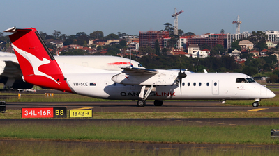 A picture of VHSCE - De Havilland Canada Dash 8300 - Qantas - © Robbie Mathieson