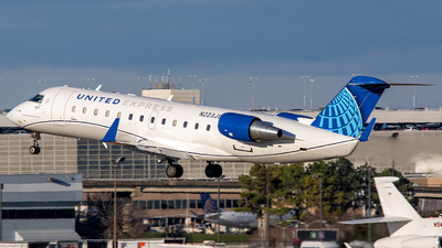 A picture of N223JS - Mitsubishi CRJ200ER - United Airlines - © Roger M