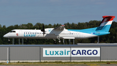 A picture of LXLQI - De Havilland Canada Dash 8400 - Luxair - © Volker Hilpert