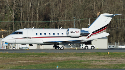 A picture of N240QS - Bombardier Challenger 650 - NetJets - © SpotterPowwwiii