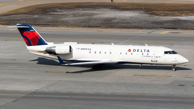 A picture of N8894A - Mitsubishi CRJ200LR - Delta Air Lines - © John Newsome