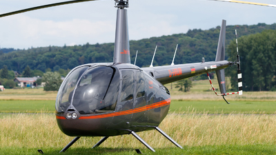 A picture of DHRUM - Robinson R44 Raven II - [14287] - © Oliver Richter