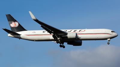 A picture of CFGSJ - Boeing 76739H(ER)(BCF) - Cargojet Airways - © Chris Pitchacaren