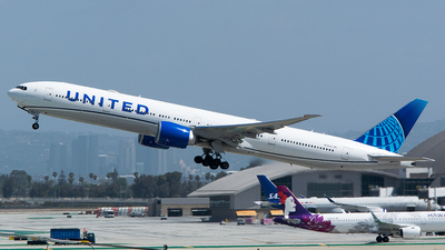 A picture of N2352U - Boeing 777300(ER) - United Airlines - © John Newsome