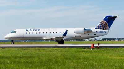 A picture of N430AW - Mitsubishi CRJ200LR - United Airlines - © Ben Suskind