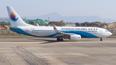 A picture of B1159 - Boeing 73783Z - Donghai Airlines - © Kevin Chung - AHKGAP