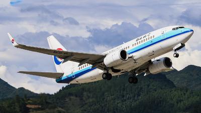 A picture of B5215 - Boeing 73775C - Xiamen Air - © Sebastian Shen