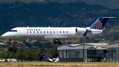 A picture of N979SW - Mitsubishi CRJ200LR - United Airlines - © Ricky Teteris