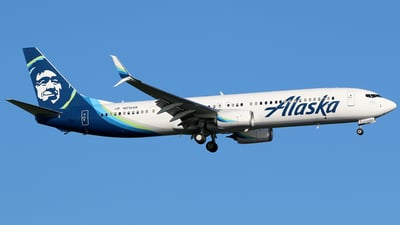 A picture of N215AK - Boeing 737990(ER) - Alaska Airlines - © Kaz T