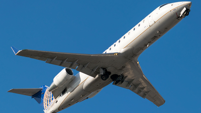 A picture of N959SW - Mitsubishi CRJ200LR - United Airlines - © Ricky Teteris