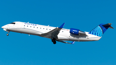 A picture of N246PS - Mitsubishi CRJ200LR - United Airlines - © Ricky Teteris