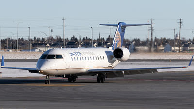 A picture of N923SW - Mitsubishi CRJ200LR - United Airlines - © Mike MacKinnon
