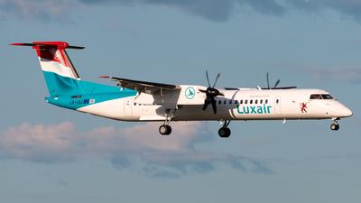 A picture of LXLQJ - De Havilland Canada Dash 8400 - Luxair - © Andre M.