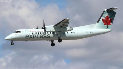 A picture of CGTAG - De Havilland Canada Dash 8300 - Air Canada - © Guy Langlois