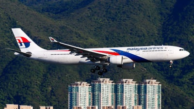 A picture of 9MMTD - Airbus A330323 - Malaysia Airlines - © Chow Kin Hei - AHKGAP