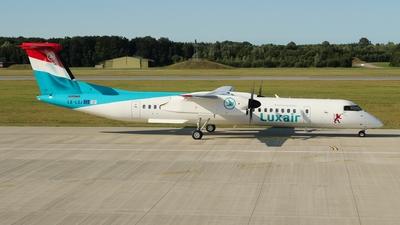 A picture of LXLQJ - De Havilland Canada Dash 8400 - Luxair - © Valentin Jahn