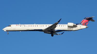 A picture of N918XJ - Mitsubishi CRJ900LR - Delta Air Lines - © Xiamen Air 849 Heavy