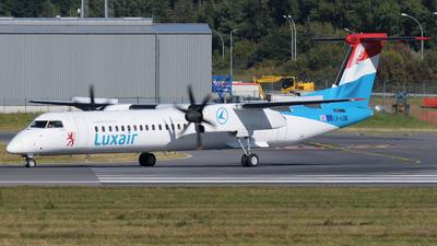 A picture of LXLQB - De Havilland Canada Dash 8400 - Luxair - © Tom Mousel