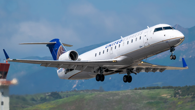 A picture of N901EV - Mitsubishi CRJ200ER - United Airlines - © Ricky Teteris