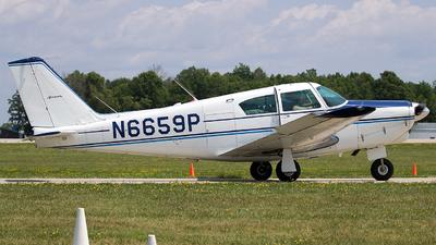 A picture of N6659P - Piper PA24250 Comanche - [241782] - © Eric Page Lu