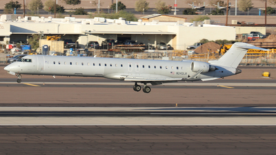 A picture of N242LR - Mitsubishi CRJ900ER - American Airlines - © Sam Thomas
