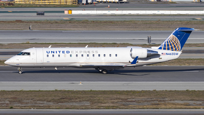 A picture of N465SW - Mitsubishi CRJ200LR - United Airlines - © David Lee